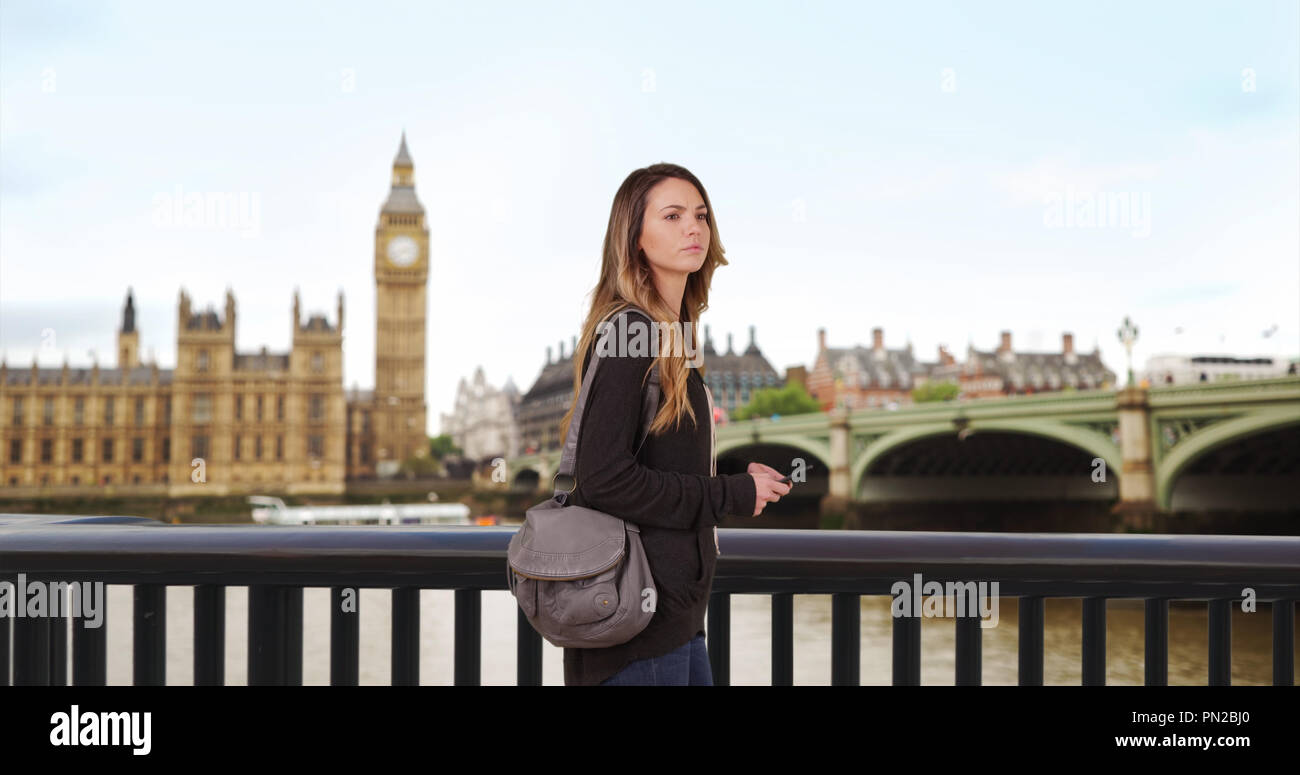 Caucasian woman lost in London uses smartphone for directions Stock Photo