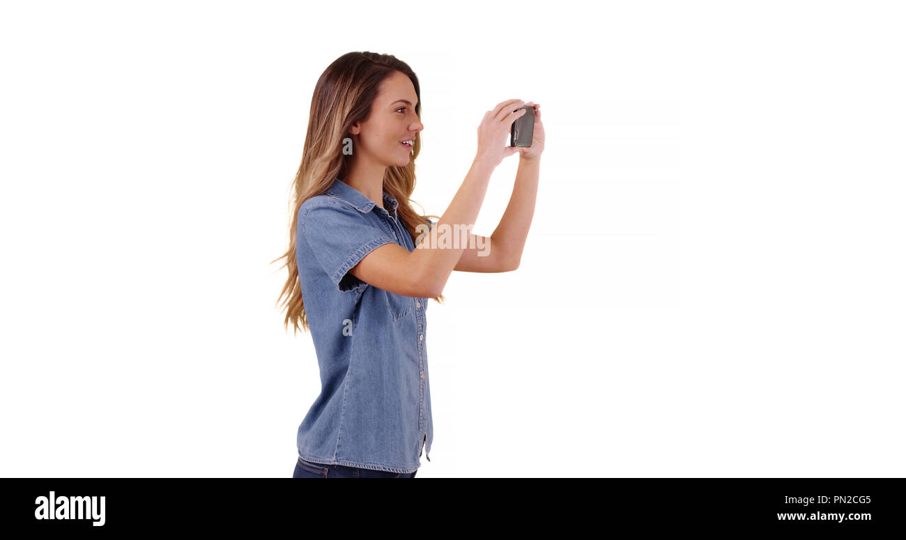 Woman tourist taking pictures of summer vacation on white background - Stock Image