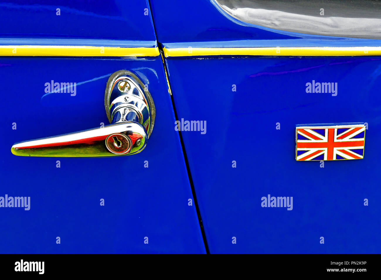 Whitley Bay Motor Show vintage blue car and yellow trim door with union flag badge - Stock Image