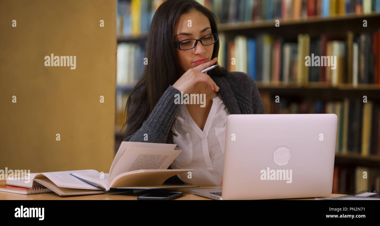 The Benefits Of Learning English Essay Hispanic Woman With Glasses Writes An Essay For Class On Computer Proposal Essays also Apa Sample Essay Paper Hispanic Woman With Glasses Writes An Essay For Class On Computer  Science Fiction Essay