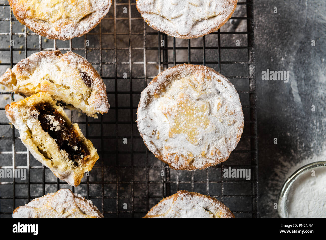Mince pies, traditional christmas food made from all butter shortcrust pastry pies deep filled with plump vine fruits, such as cranberries, clementine - Stock Image