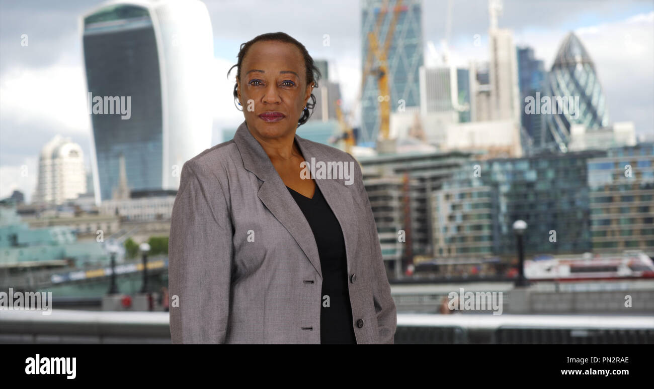 African American woman in business suit looks at camera in