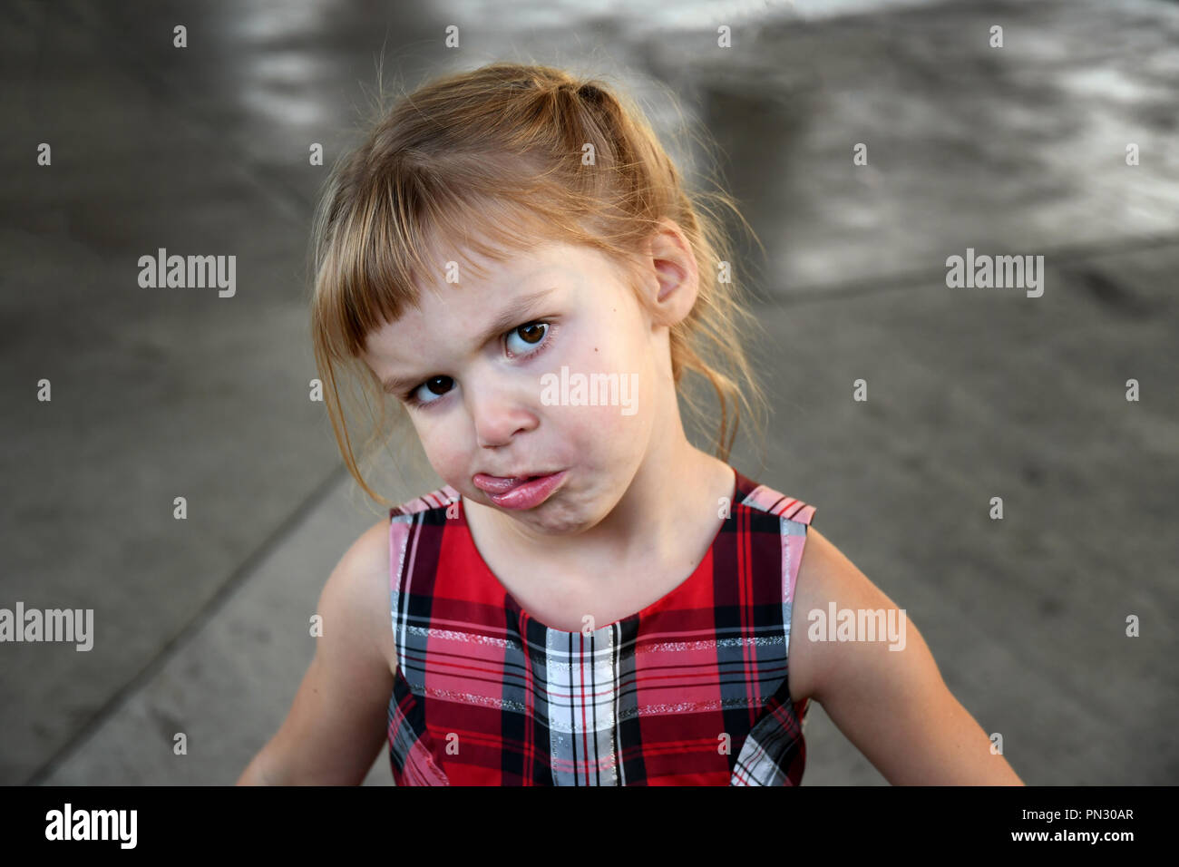 4-year-old girl making a silly face Stock Photo