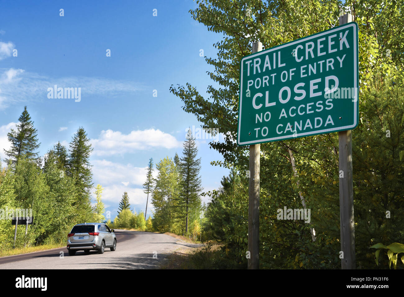 STATE HIGHWAY 486, MONTANA, USA: September 9, 2018: An SUV drives past a sign stating the Trail Creek Port of Entry is closed with no access to Canada Stock Photo
