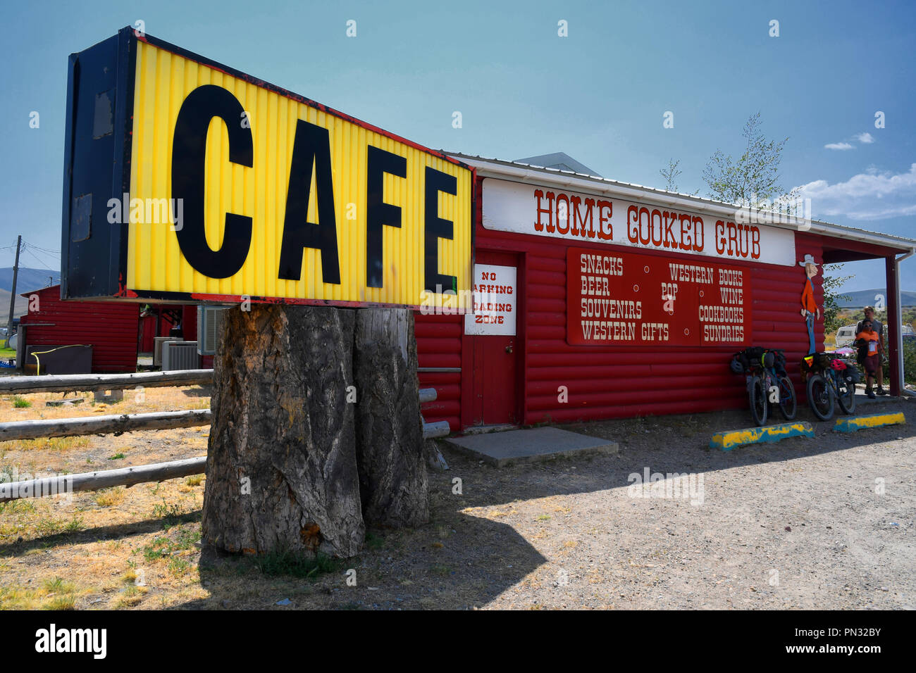 LIMA, MONTANA, USA - August 11, 2018: Exterior of a log cabin cafe featuring home cooked grub Stock Photo