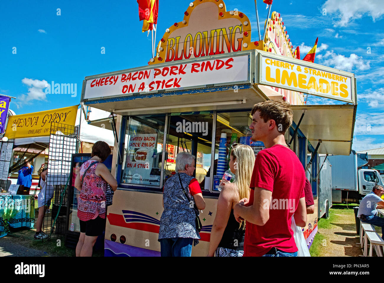 Hutchinson Kansas, USA, September 15, 2018 Fair goers peruse the menus being offered at food booths along the midway at the State Fair. - Stock Image
