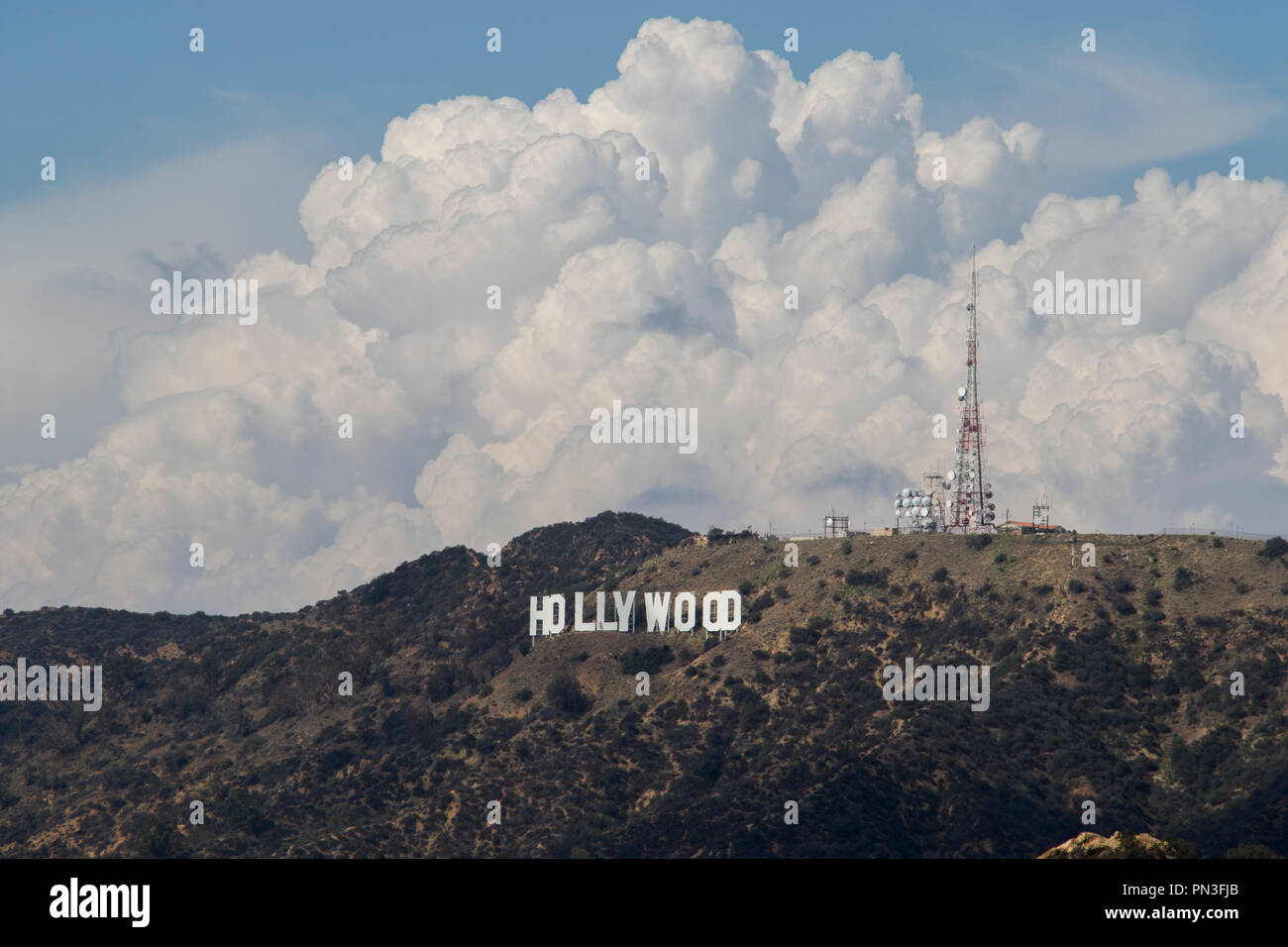 Hollywood sign in the hills of Los Angeles with clouds in the sky on a summer day. - Stock Image