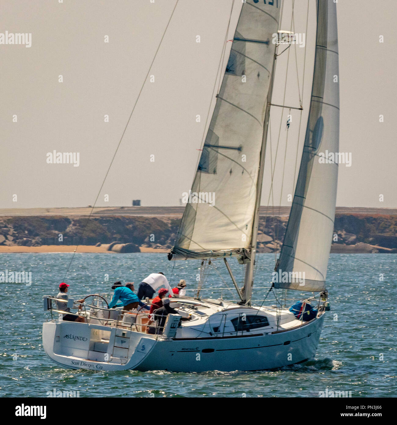 The team is working to trim the yacht for best possible performance - Stock Image