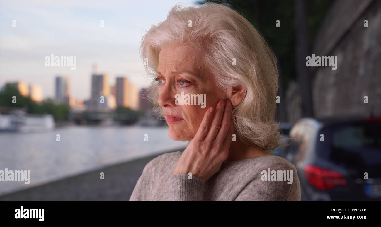 Sad stressed woman on vacation in Paris looking at river Seine - Stock Image