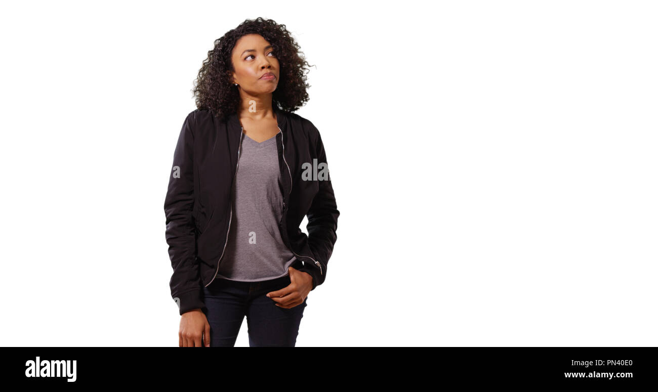 Portrait of pensive African-American female millennial on white copy space - Stock Image
