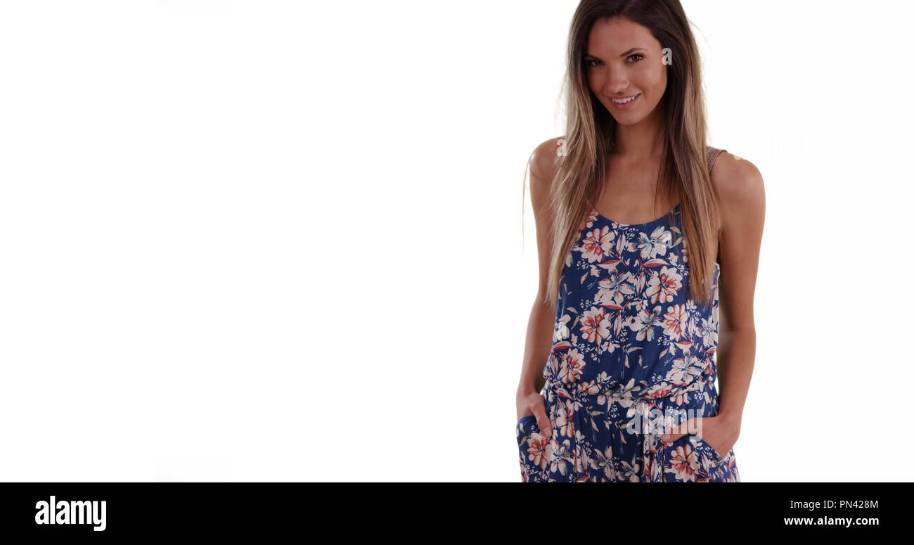 ec307d5efc6 Pretty millennial woman in romper looking at camera on solid white  background