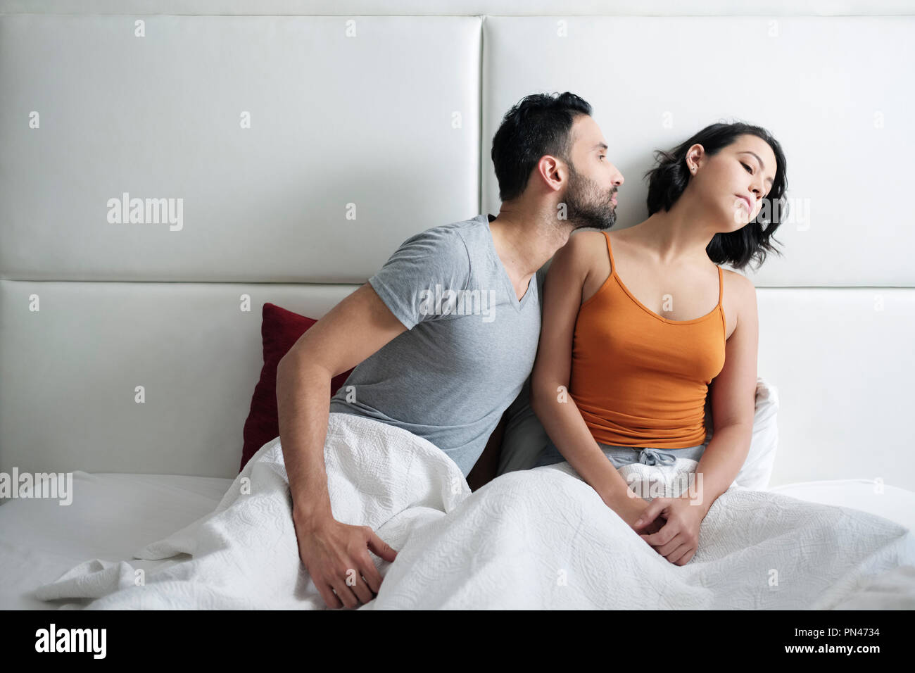 Relationship Problems With Angry Woman In Bed - Stock Image