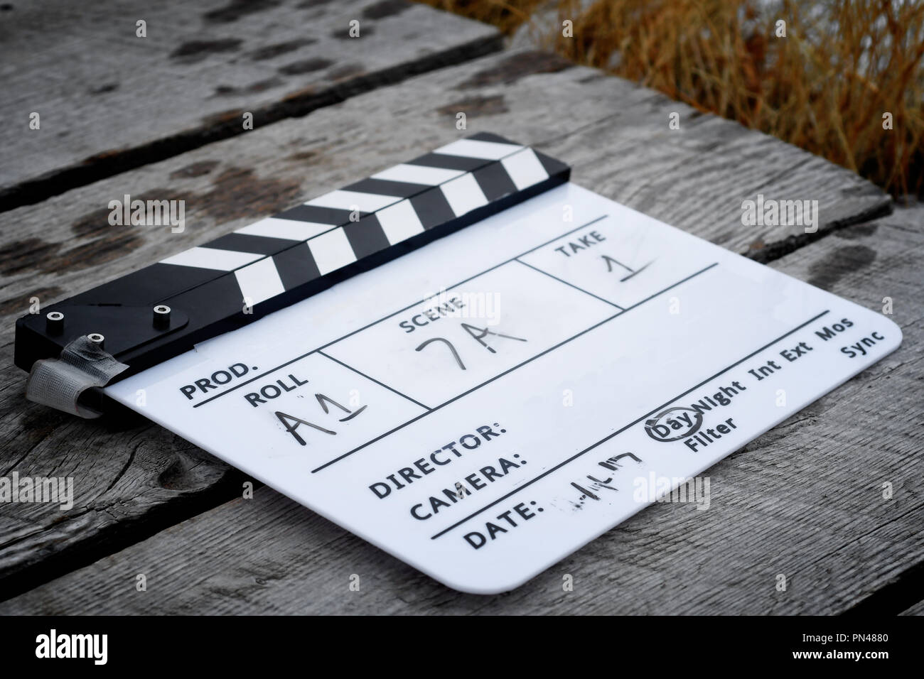 Directors clapboard on a wooden walkway on a movie set Stock Photo