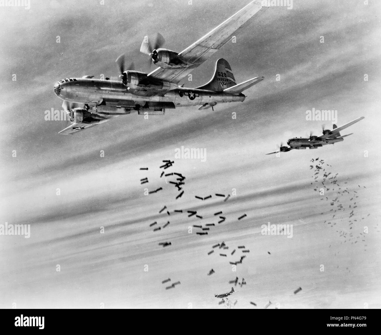 Bombs over Burma -  Aerial view of bombs being dropped from two 20th Bomber Command Superfortresses. - Stock Image