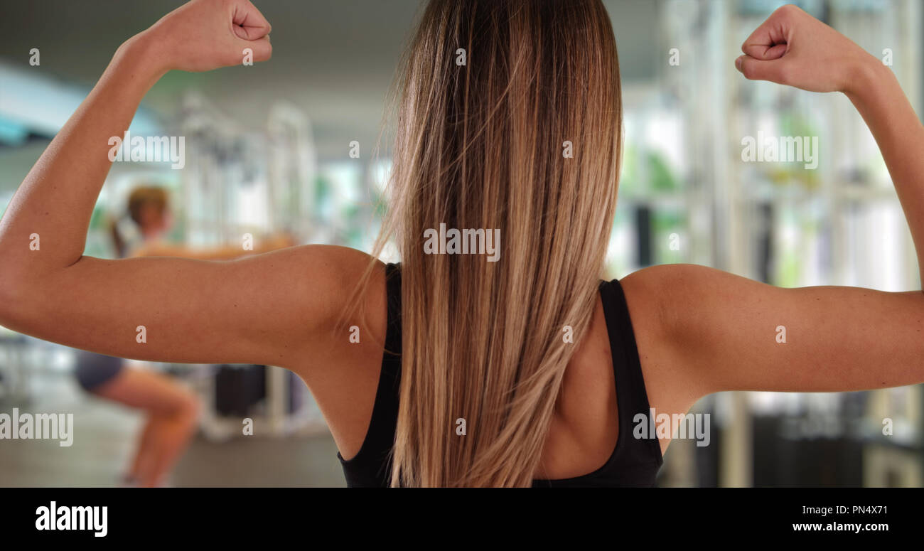 Healthy White Girl In Her 20s Showing Off Bicep Muscles After