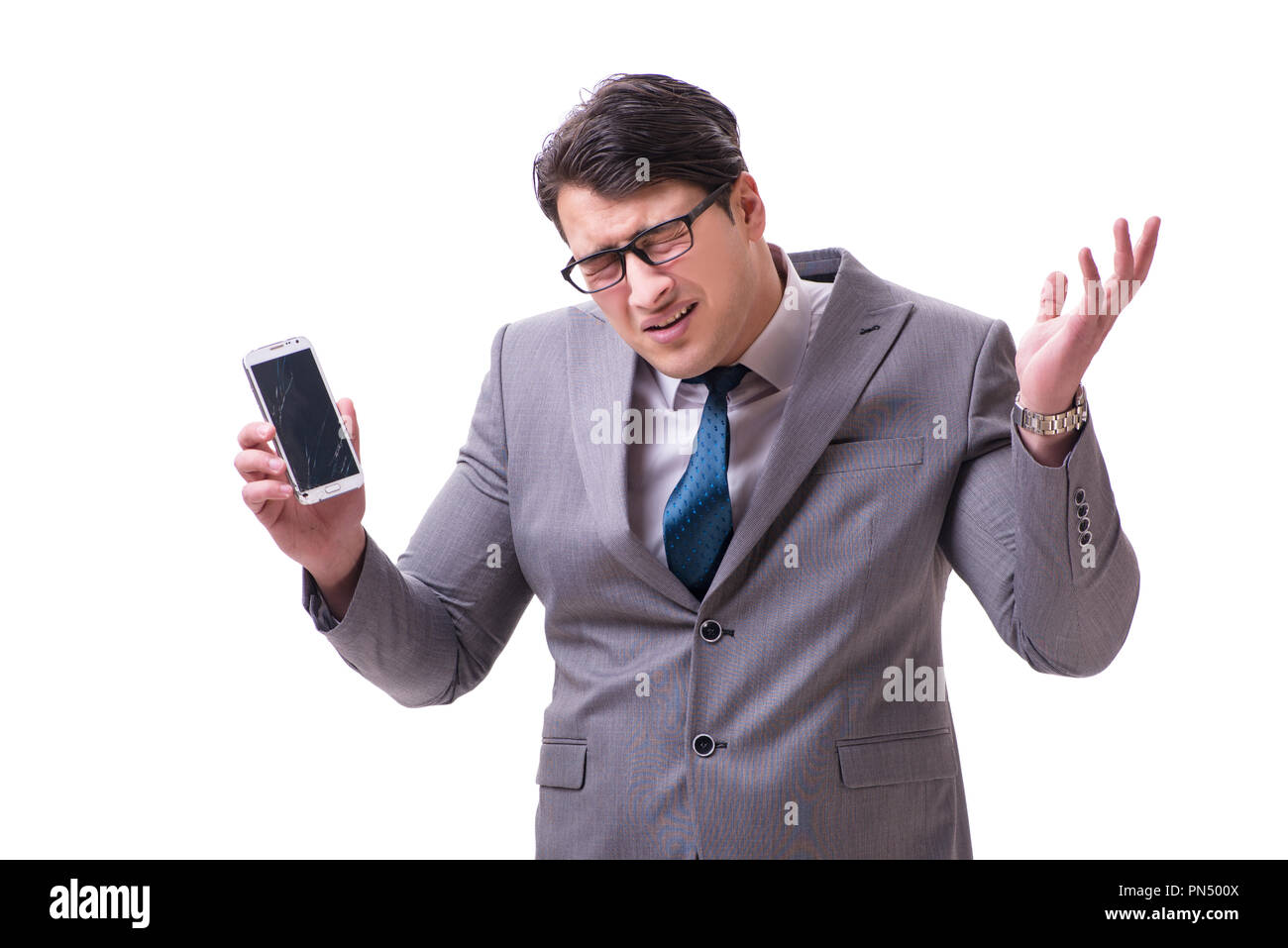 Businessman with mobile phone isolated on white - Stock Image