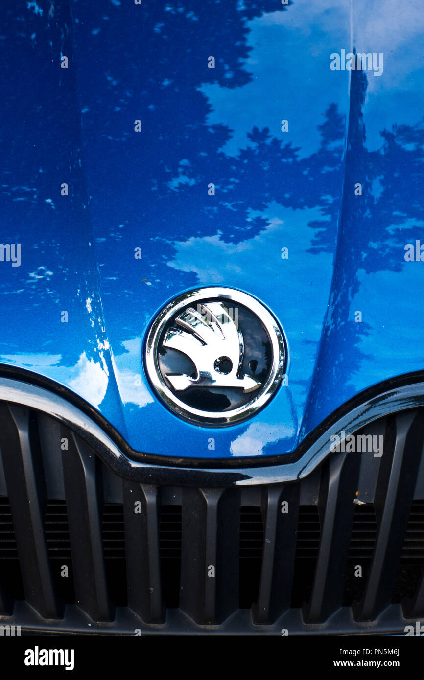 logo of Skoda on the grille of a blue car - Stock Image
