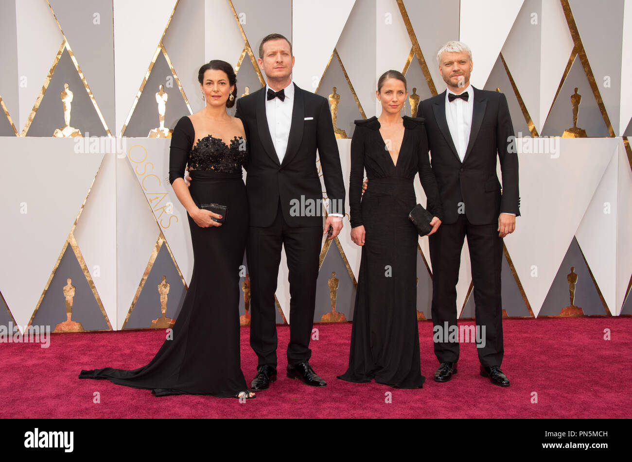 Oscar®-nominee, Tobias Lindholm (2nd from left), and guests arrive at The 88th Oscars® at the Dolby® Theatre in Hollywood, CA on Sunday, February 28, 2016.  File Reference # 32854_022THA  For Editorial Use Only -  All Rights Reserved - Stock Image