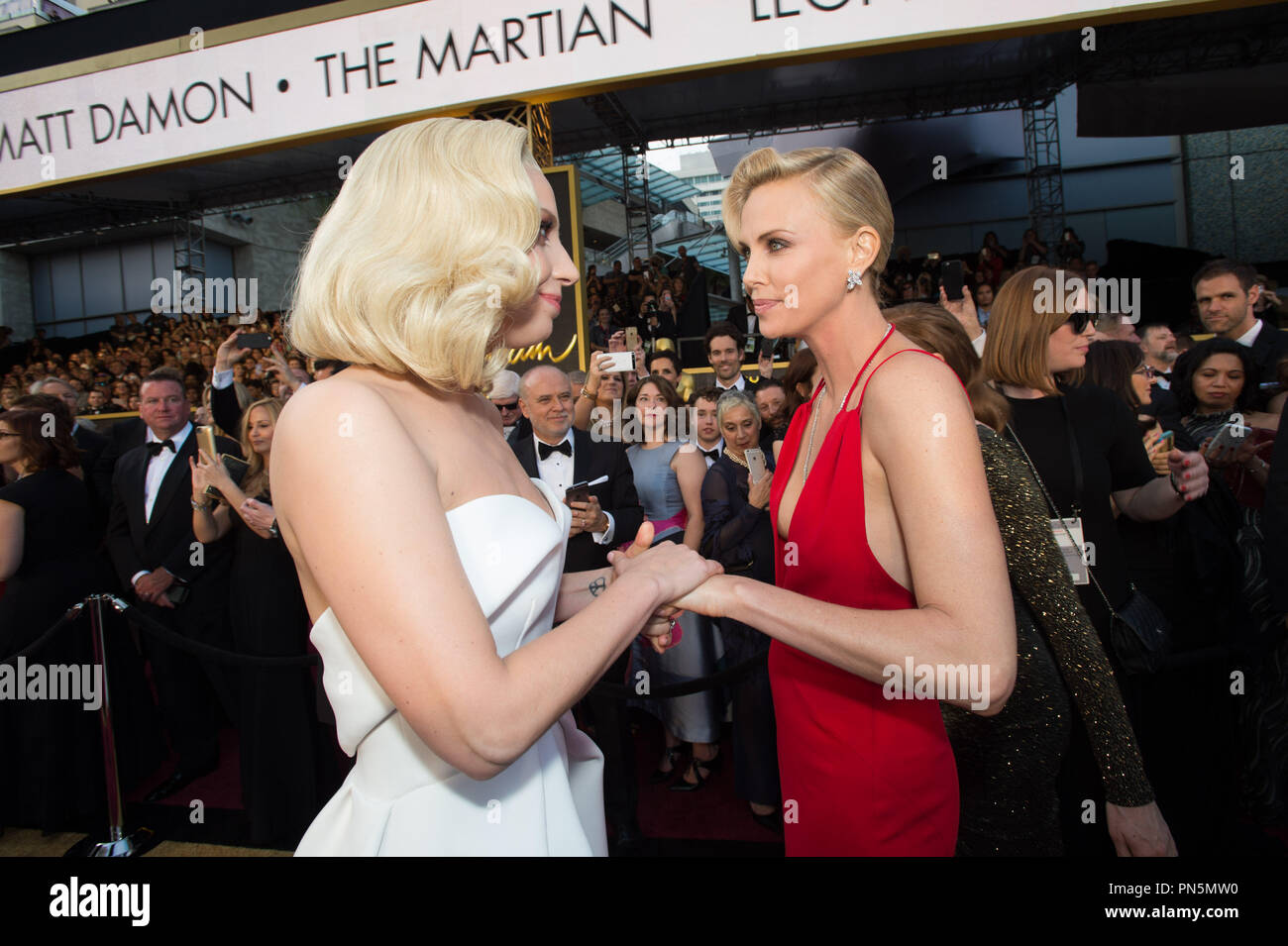 Oscar®-nominee Lady Gaga and Charlize Theron arrive at The 88th Oscars® at the Dolby® Theatre in Hollywood, CA on Sunday, February 28, 2016.  File Reference # 32854 349THA  For Editorial Use Only -  All Rights Reserved Stock Photo
