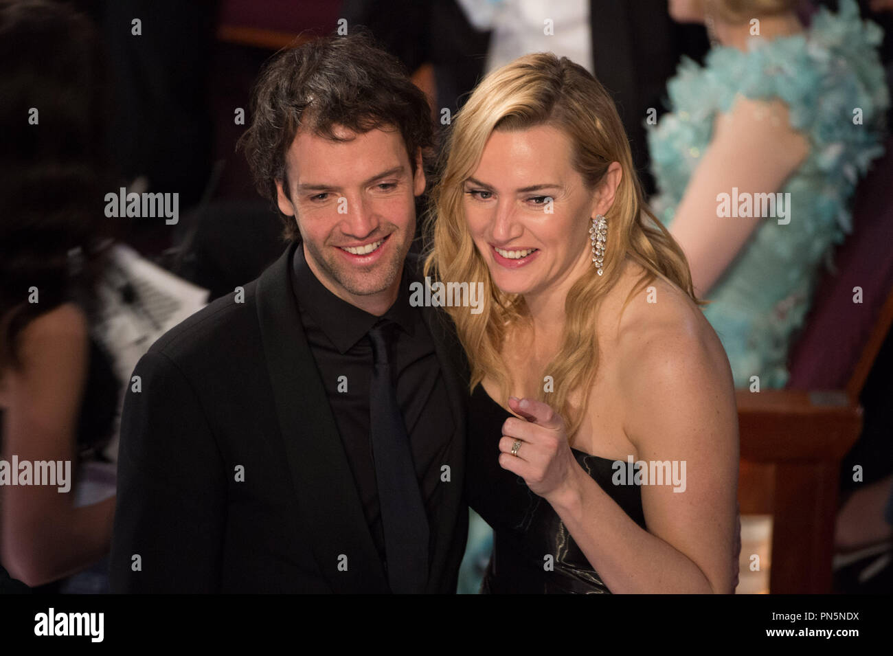 Kate Winslet and husband Ned Rocknroll during the live ABC Telecast of The 88th Oscars® at the Dolby® Theatre in Hollywood, CA on Sunday, February 28, 2016.  File Reference # 32854_780THA  For Editorial Use Only -  All Rights Reserved - Stock Image