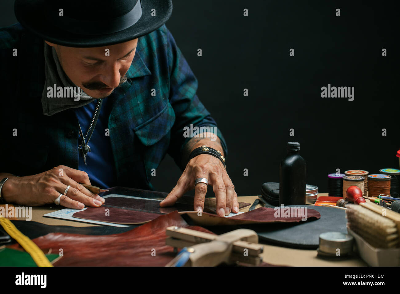Modelling design of a shoes.Workplace of shoe designer Selective focus. - Stock Image