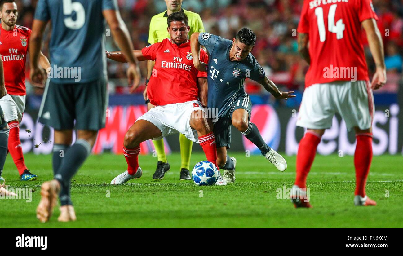 Lisbon, Portugal. 19th Sep, 2018. LISBON, PORTUGAL - SEPTEMBER 19: Gabriel Appelt of SL Benfica (L) vies with James Rodriguez of Bayern Munchen (R) for the possession of the ball during the UEFA Champions League match between Benfica and Bayern Munchen at Estadio da Luz on September 19, 2018 in Lisbon, Portugal. (Photo by Carlos Rodrigues/Firosport) | usage worldwide Credit: dpa/Alamy Live News - Stock Image