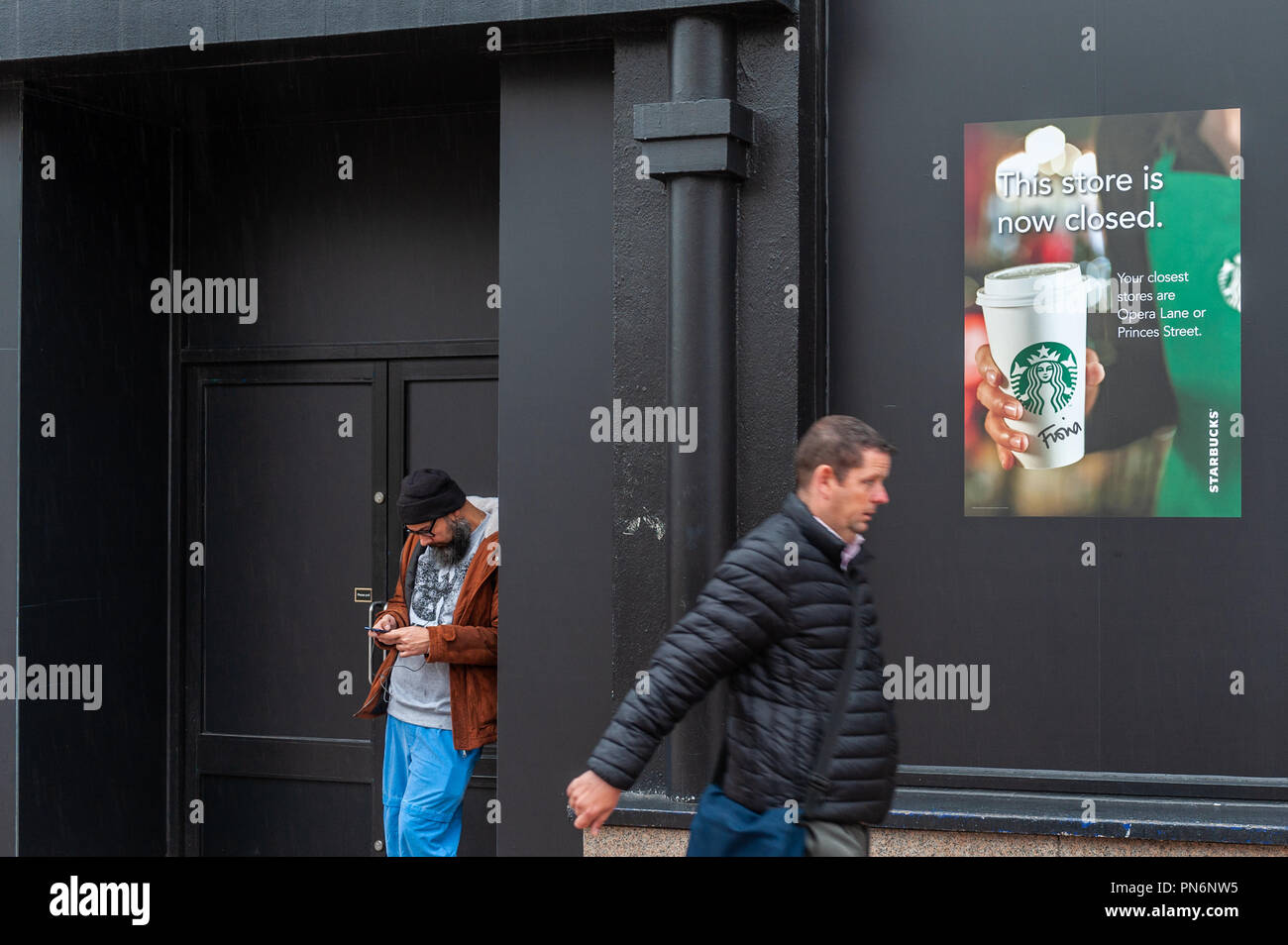 Patrick Street, Cork, Ireland. 20th Sept, 2018. Starbucks Café is closed after a year of battles with An Bord Pleanála, the Irish Planning Board. The building used to house a mobile phone shop but Starbucks took it over and didn't apply for planning permission. Starbucks then removed chairs, tables and customer toilets and claimed that made it a shop, which the planning board objected to. Starbucks finally moved out this week. Credit: Andy Gibson/Alamy Live News. - Stock Image