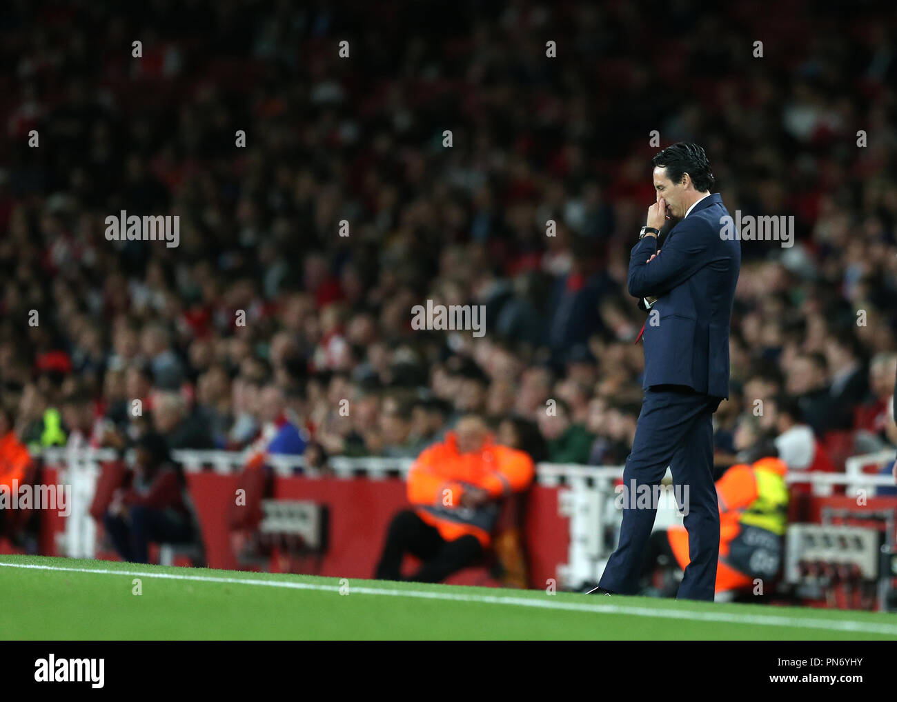 Emirates Stadium, London, UK. 20th Sep, 2018. UEFA Europa League football, Arsenal versus Vorskla Poltava; Arsenal manager Unai Emery looking down onto the pitch in thought Credit: Action Plus Sports Images/Alamy Live News - Stock Image