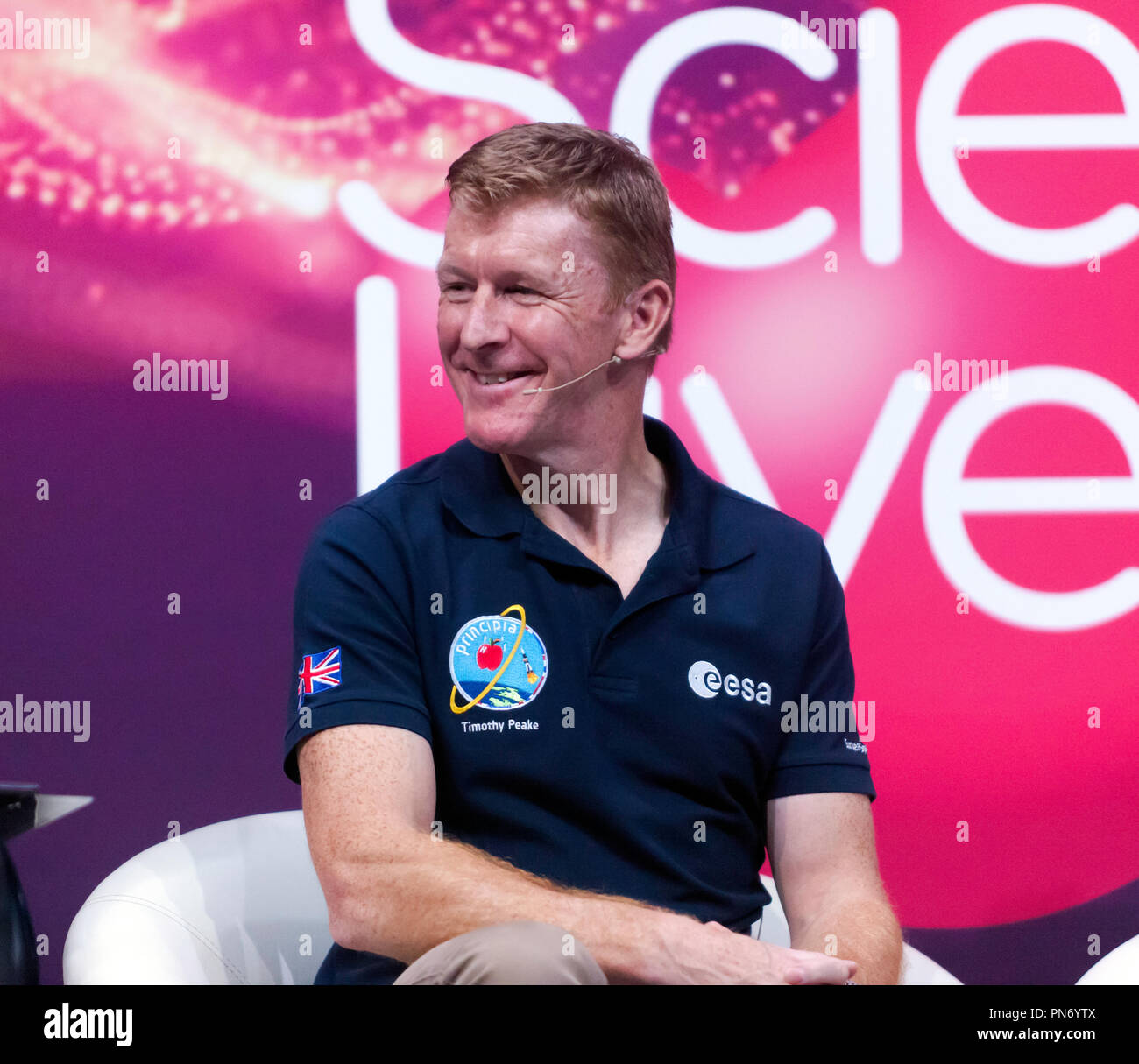 Astronaut Tim Peak participating in a talk about life in Space and the wild corners of Earth on the main stage at New Scientist Live, ExCel London, UK - Stock Image