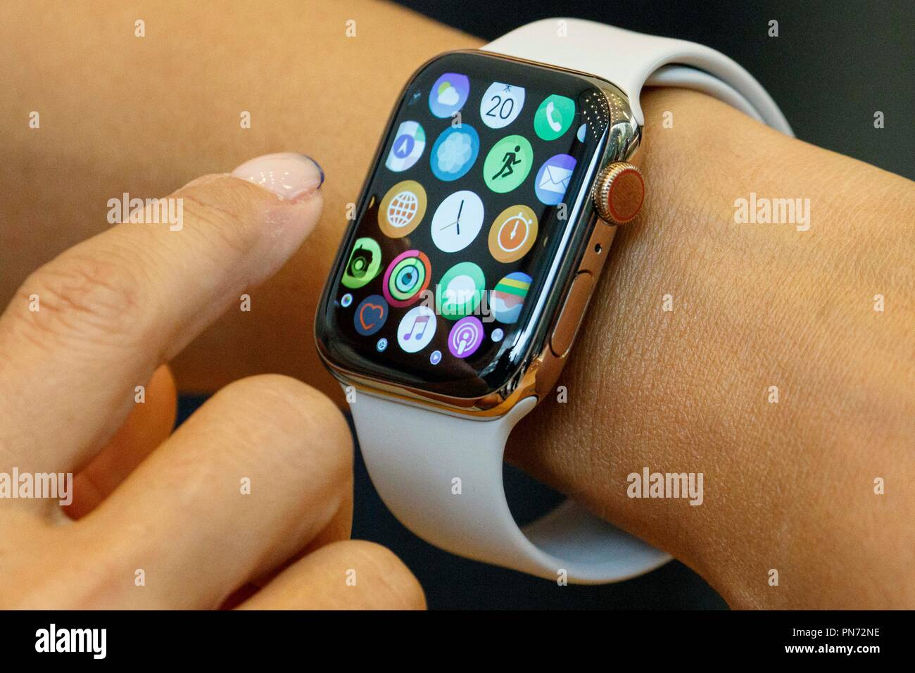 A woman tests a new iWatch (Series 4) at the Apple Store in Omotesando on September 21, 2018, Tokyo, Japan. Apple fans lined up patiently in the early morning rain to get the new iPhone models (XS and XS Max) and the new iWatch (Series 4). The new iPhone XS costs JPY 112,800 for the 64 GB model, the iPhone XS Max costs JPY 124,800 JPY for the 64 GB model, and iWatch Series 4 costs JPY 45,800. Credit: Rodrigo Reyes Marin/AFLO/Alamy Live News Stock Photo