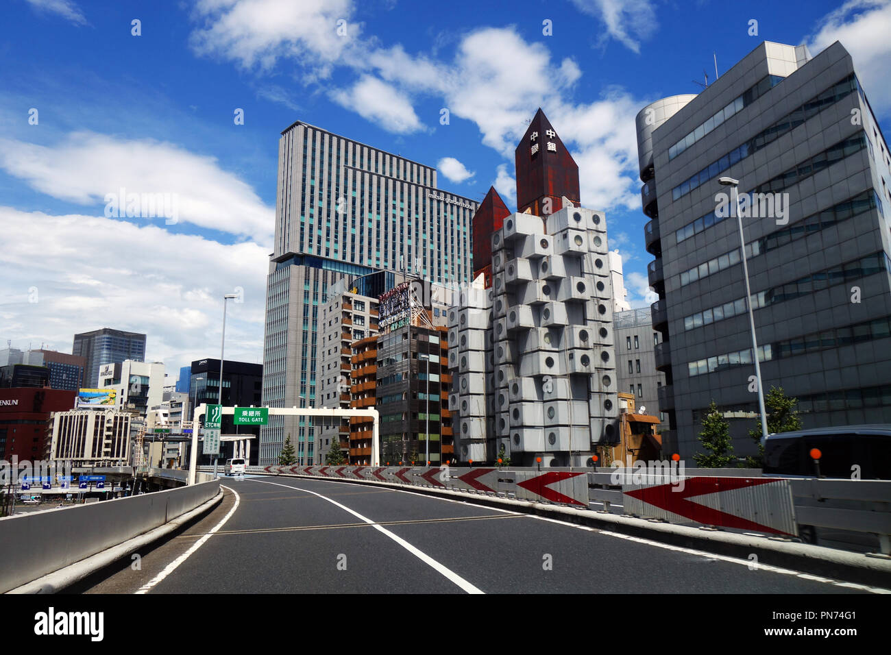Driving on tollway past Nakagin Capsule Tower, Ginza, Tokyo, Japan. No PR - Stock Image