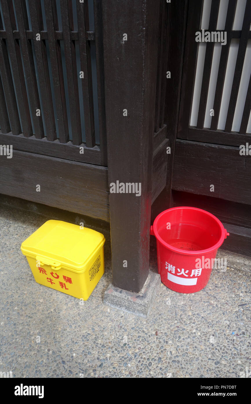 Emergency supplies including bucket of water in traditional wooden district of Kyoto, Japan. No PR - Stock Image