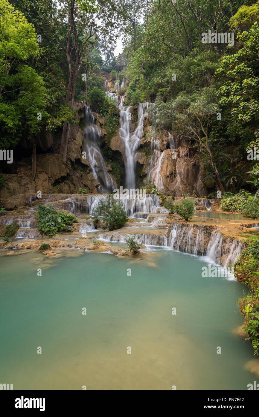 Beautiful view of the main fall at the Tat Kuang Si Waterfalls near Luang Prabang in Laos. Stock Photo