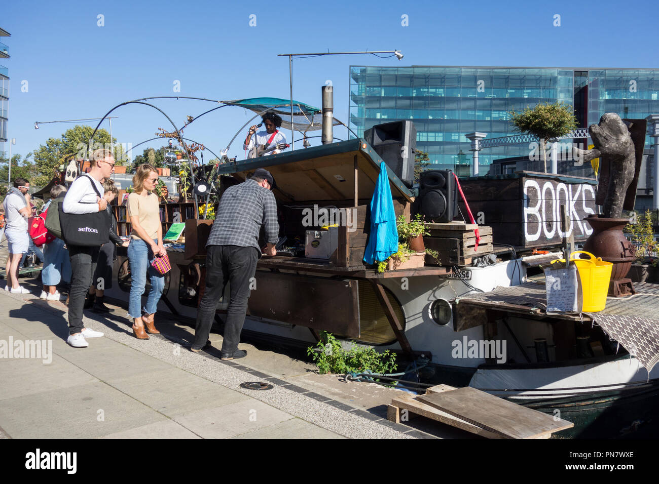 Word On The Water floating bookshop, Regent's Canal Towpath, Kings Cross, Camden, London, N1, UK - Stock Image