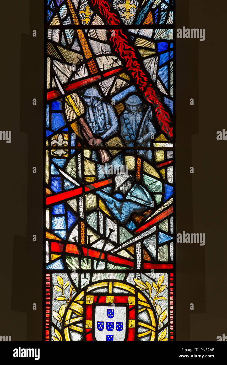 Stained glass windows / window at St James Church, Twickenham. UK.  To commemorate / commemorates losses of Portuguese soldiers in WW1 / First World War. - Stock Image