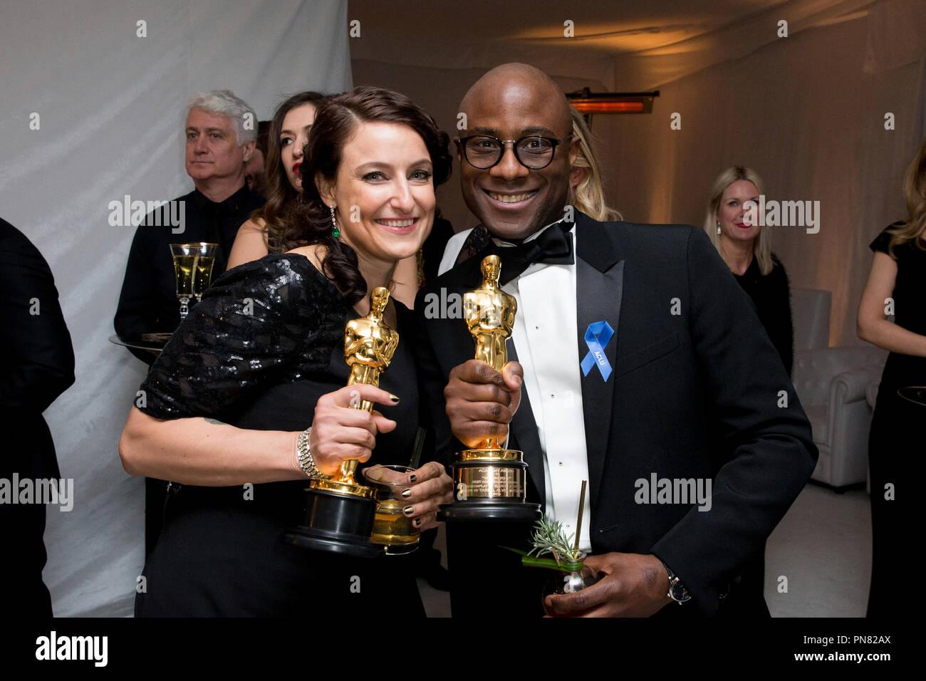 Oscar® winners Adele Romanski and Barry Jenkins pose with