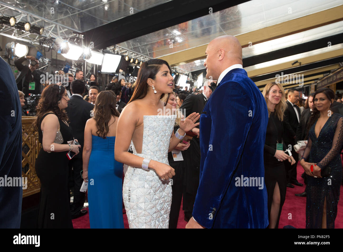 Priyanka Chopra talks with Dwayne Johnson on the red carpet of The 89th Oscars® at the Dolby® Theatre in Hollywood, CA on Sunday, February 26, 2017.  File Reference # 33242_708THA  For Editorial Use Only -  All Rights Reserved - Stock Image