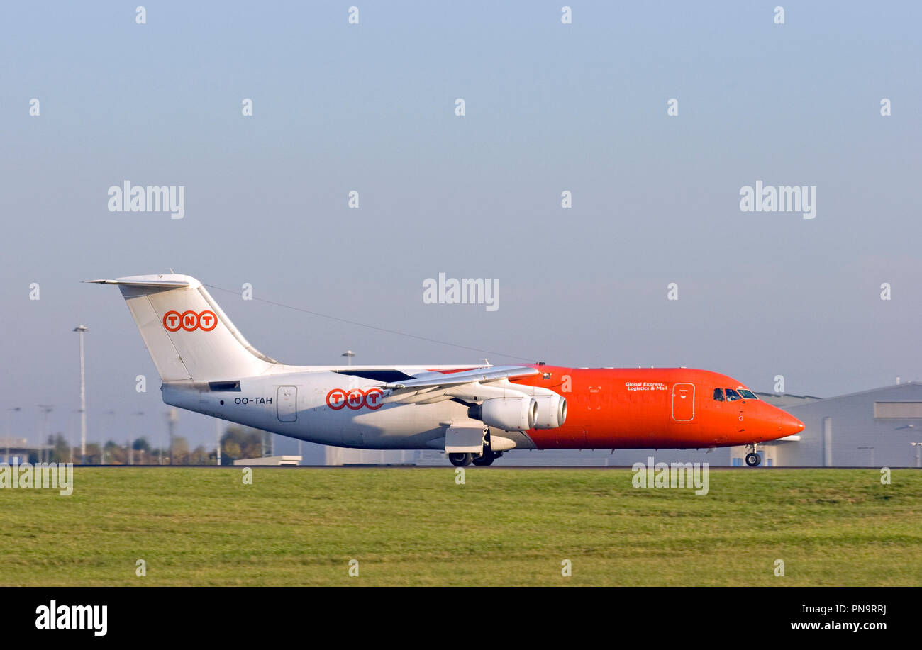 TNT Airways BAe 146-300QT freighter aircraft taxiing for take off London Stansted airport. - Stock Image