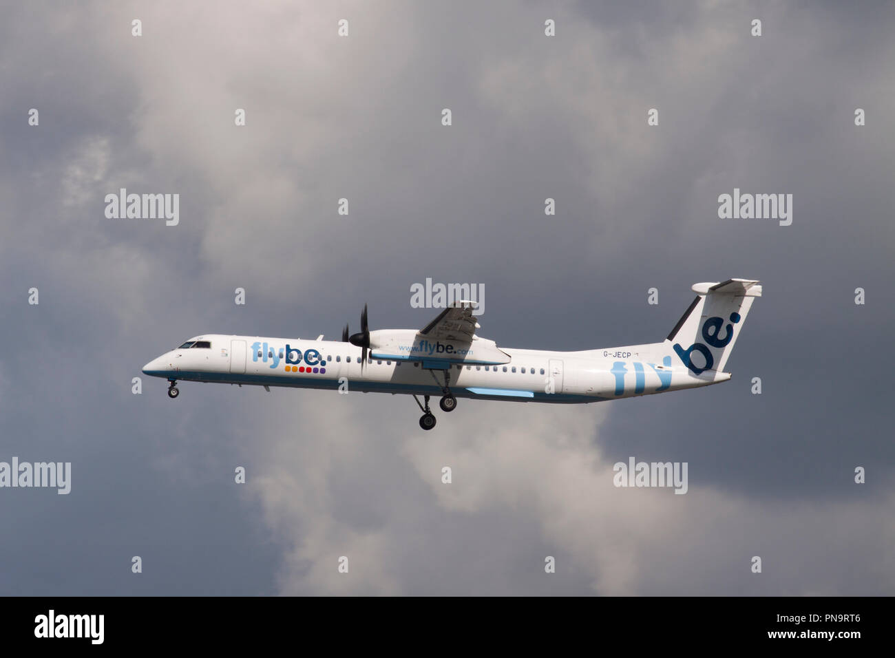 Flybe Bombardier Dash 8-Q402 turboprop aircraft landing at London Gatwick airport. - Stock Image