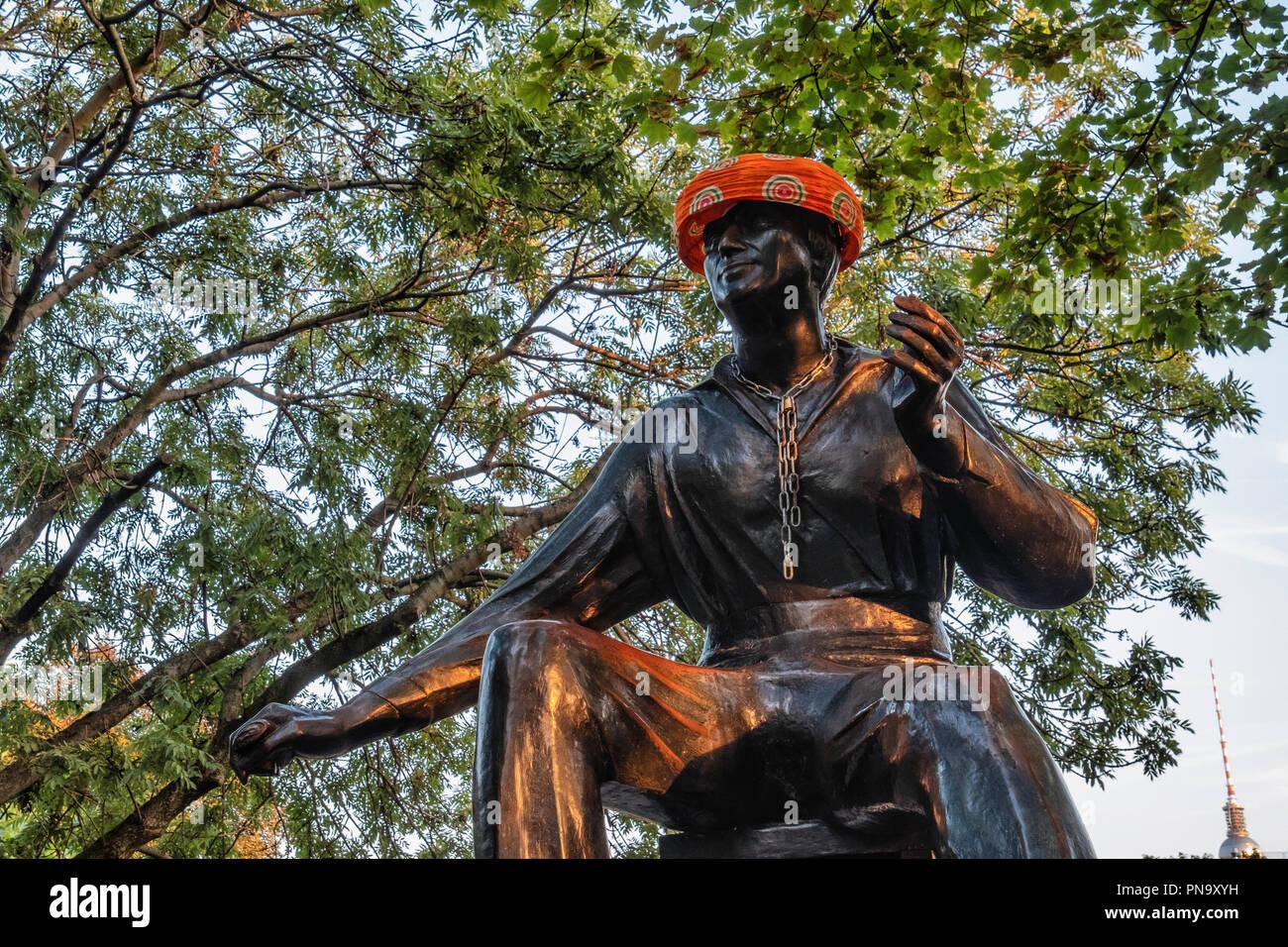 Berlin Mitte. Public art -  sculpture of Poet, Heinrich Heine monument - by sculptor, Waldemar Grzimek.                    A passerby has provided the - Stock Image