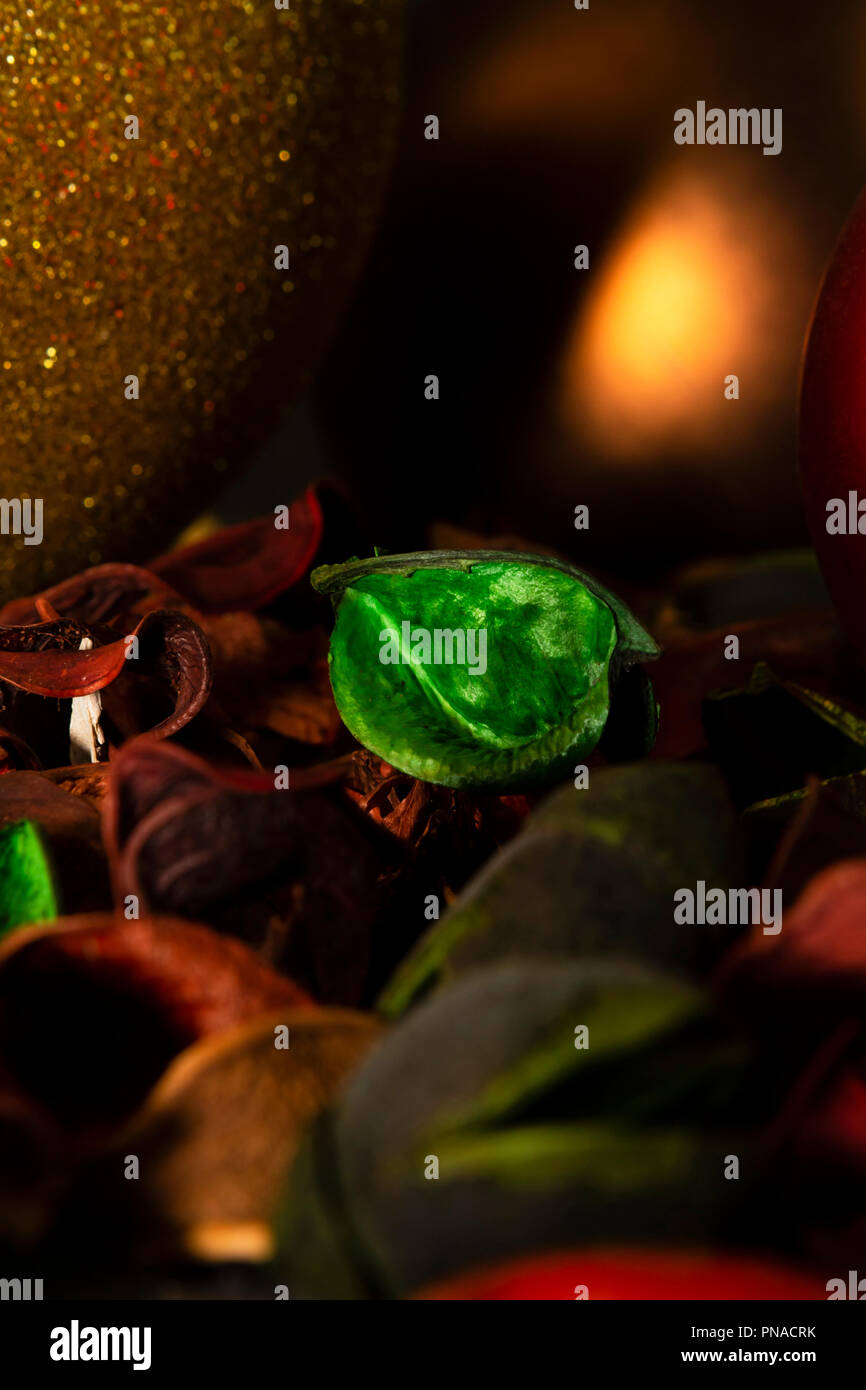 Close-up of Christmas baubles, glitter and matte, decorations and potpourri, warm winter colors, great for backgrounds. - Stock Image