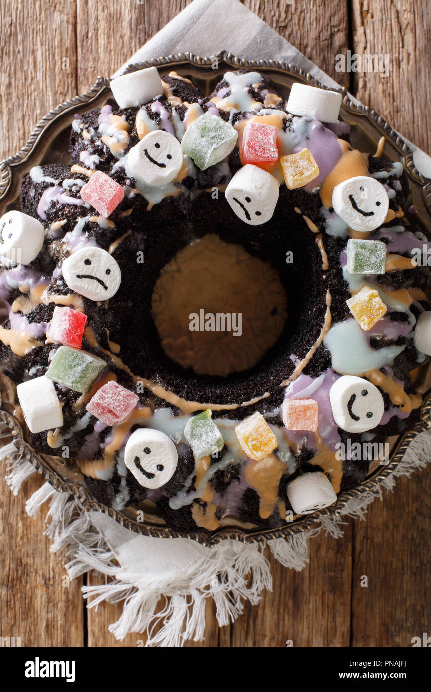 homemade halloween chocolate bundt cake with candied fruits