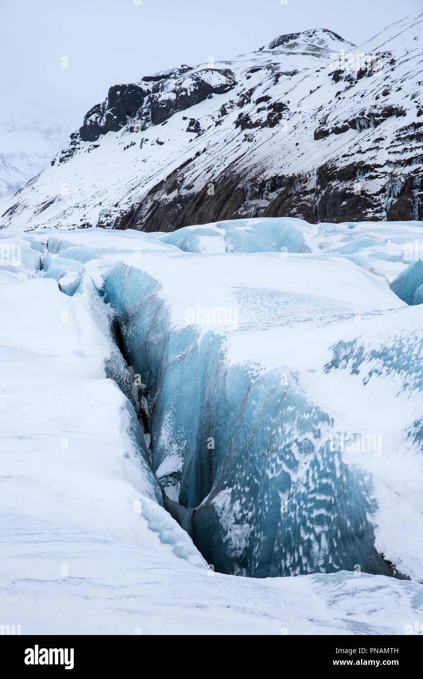 Close up showing dangerous deep crevasse fracture on Svinafellsjokull glacier an outlet glacier of Vatnajokull, South Iceland - Stock Image