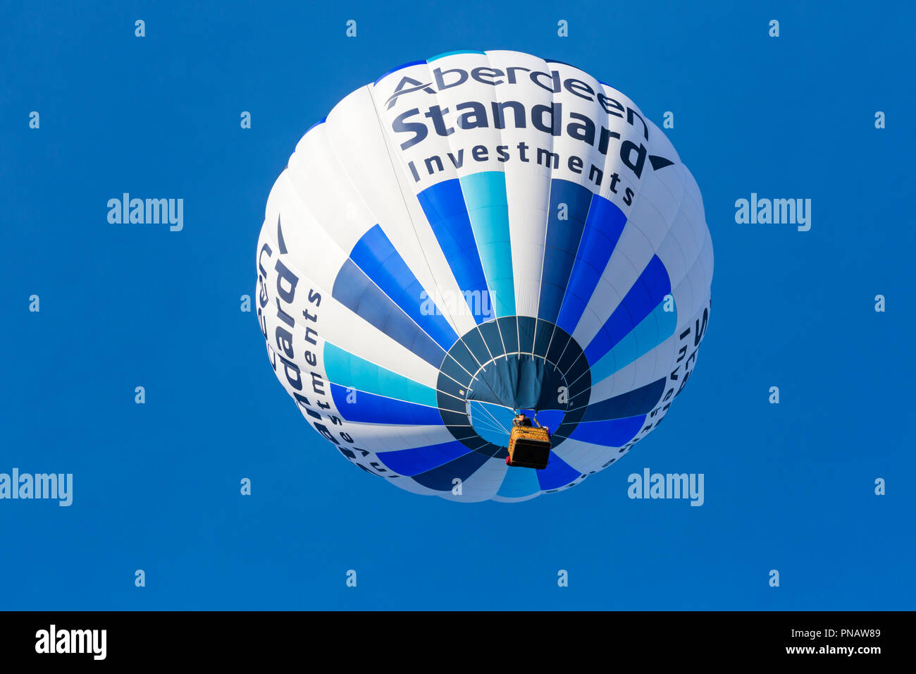 Aberdeen Standard Investments hot air balloon in the sky at Longleat Sky Safari, Wiltshire, UK in September - Stock Image