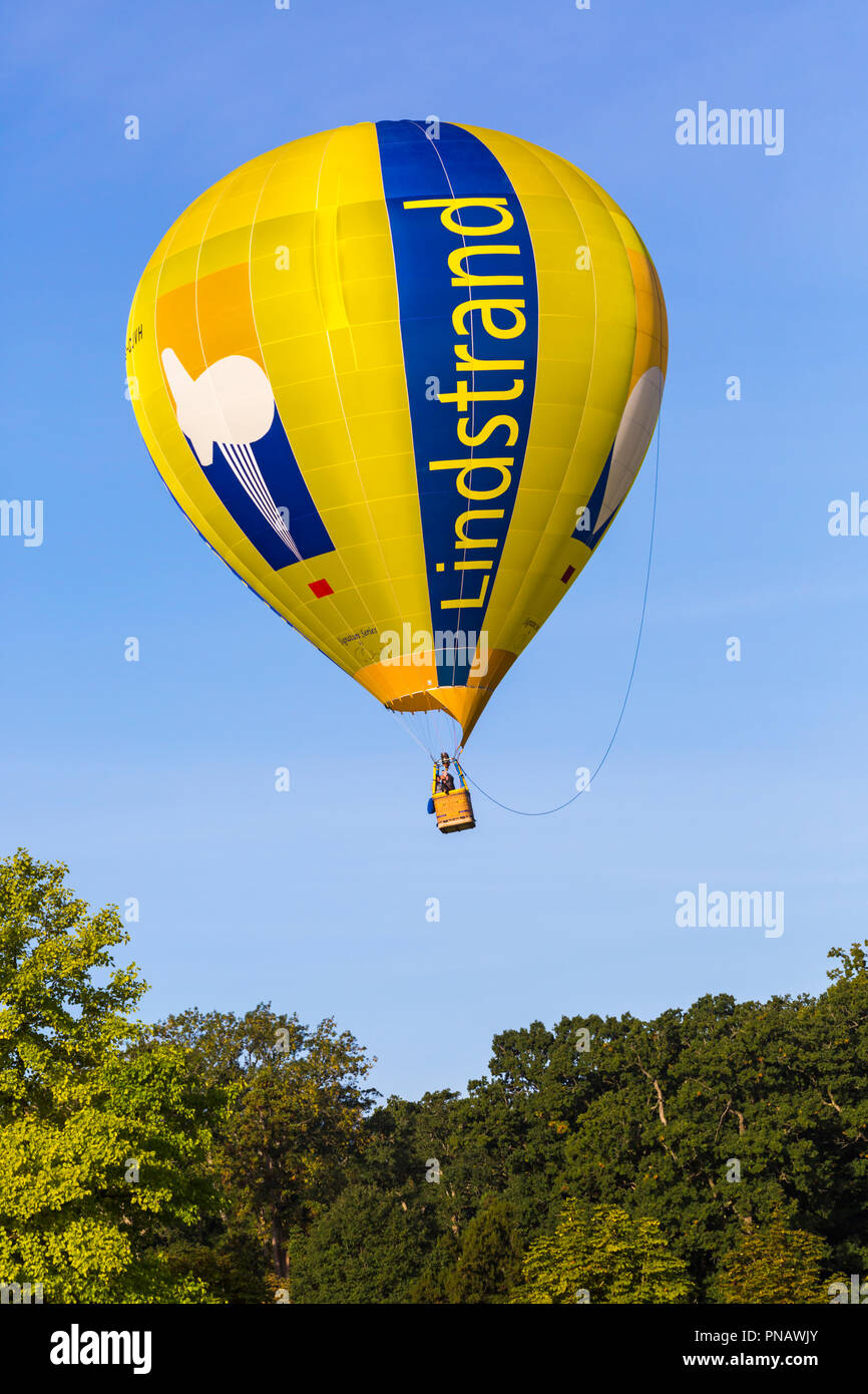 Lindstrand hot air balloon in the sky at Longleat Sky Safari, Wiltshire, UK in September Stock Photo