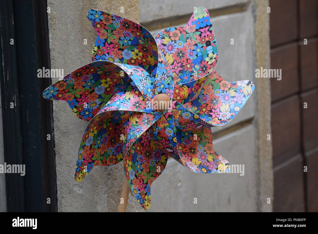 Child's colorful patterned whirligig, windmill - Stock Image