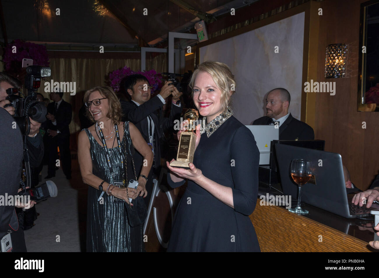 "After winning the category of BEST PERFORMANCE BY AN ACTRESS IN A TELEVISION SERIES – DRAMA for her role in ""The Handmaid's Tale,"" actress Elisabeth Moss poses backstage with her Golden Globe Award at the 75th Annual Golden Globe Awards at the Beverly Hilton in Beverly Hills, CA on Sunday, January 7, 2018. Stock Photo"