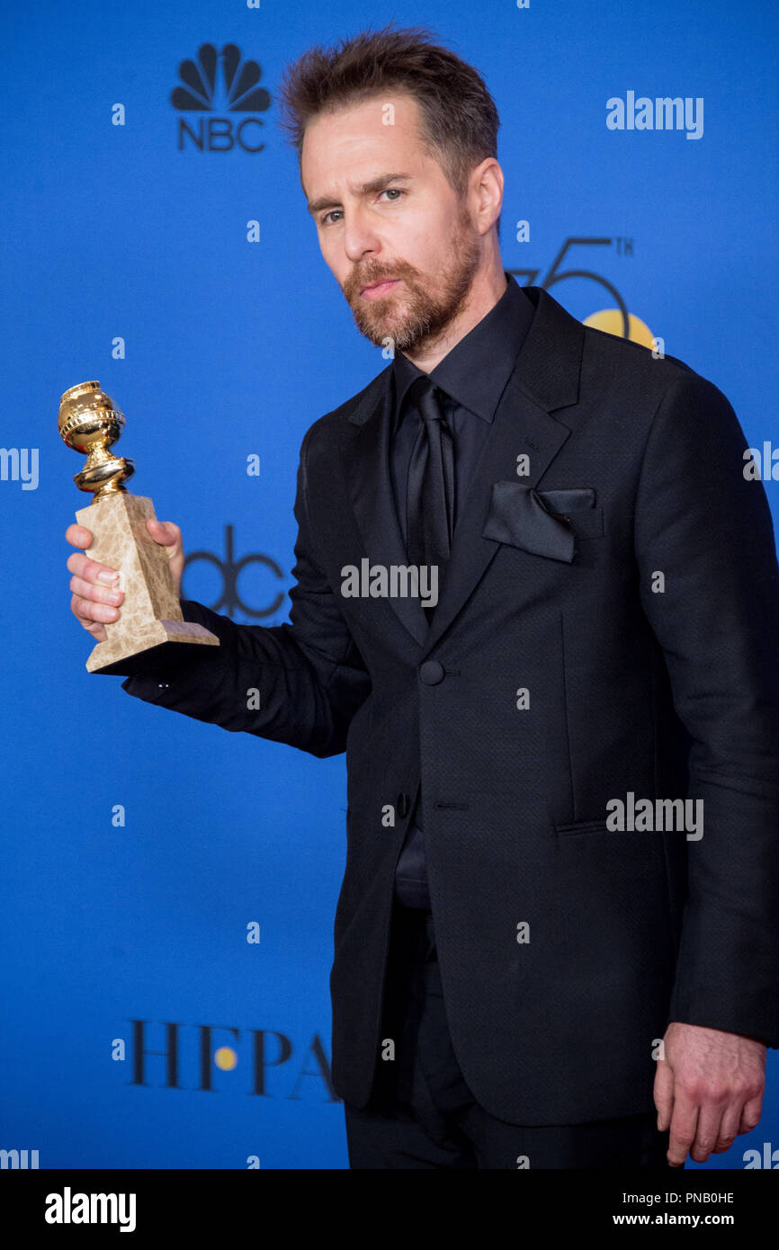 """After winning the category of BEST PERFORMANCE BY AN ACTOR IN A SUPPORTING ROLE IN A MOTION PICTURE for his work in """"Three Billboards Outside Ebbing, Missouri,"""" actor Sam Rockwell poses backstage in the press room with his Golden Globe Award at the 75th Annual Golden Globe Awards at the Beverly Hilton in Beverly Hills, CA on Sunday, January 7, 2018. Stock Photo"""