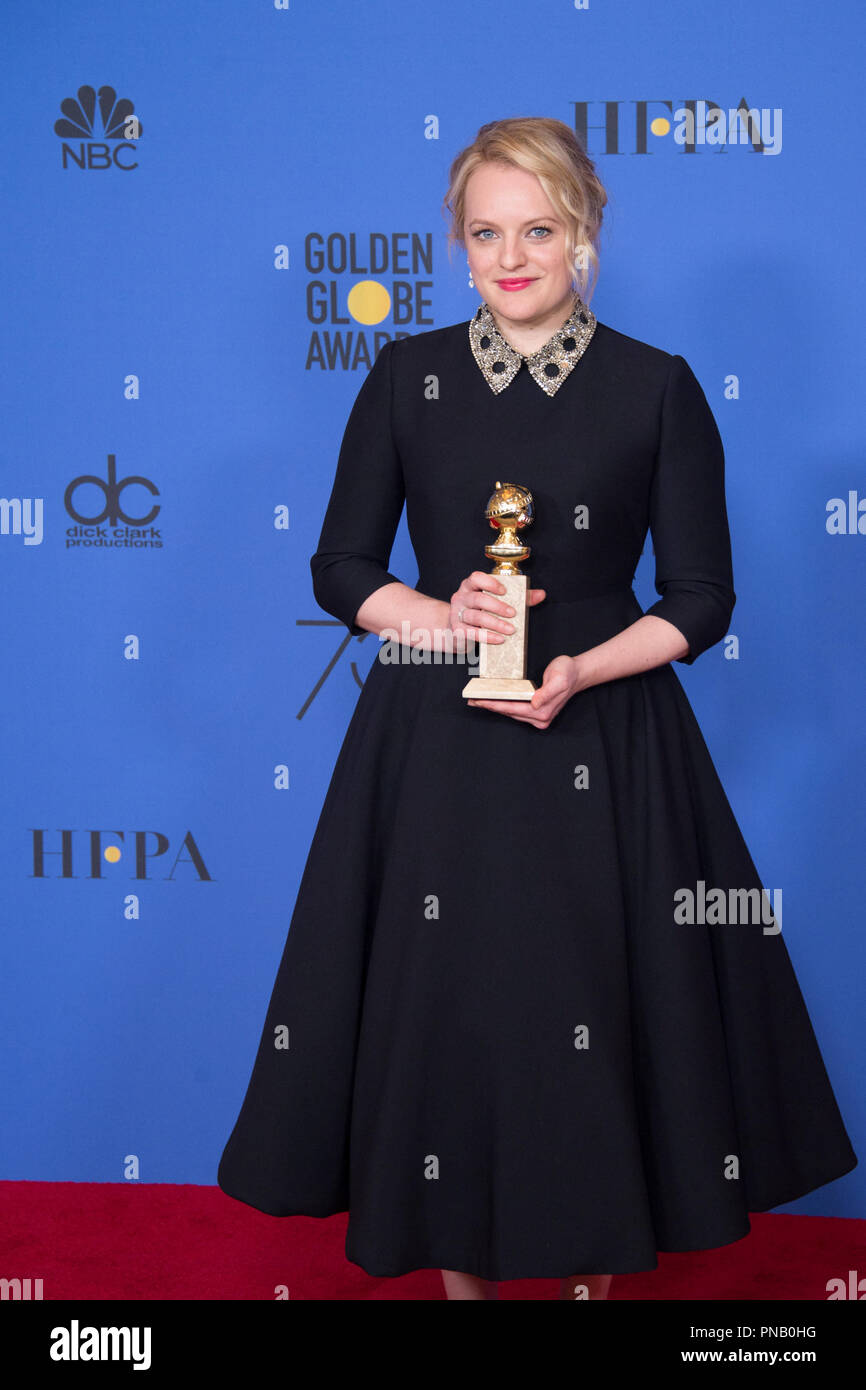 """After winning the category of BEST PERFORMANCE BY AN ACTRESS IN A TELEVISION SERIES – DRAMA for her role in """"The Handmaid's Tale,"""" actress Elisabeth Moss poses backstage in the press room with her Golden Globe Award at the 75th Annual Golden Globe Awards at the Beverly Hilton in Beverly Hills, CA on Sunday, January 7, 2018. Stock Photo"""