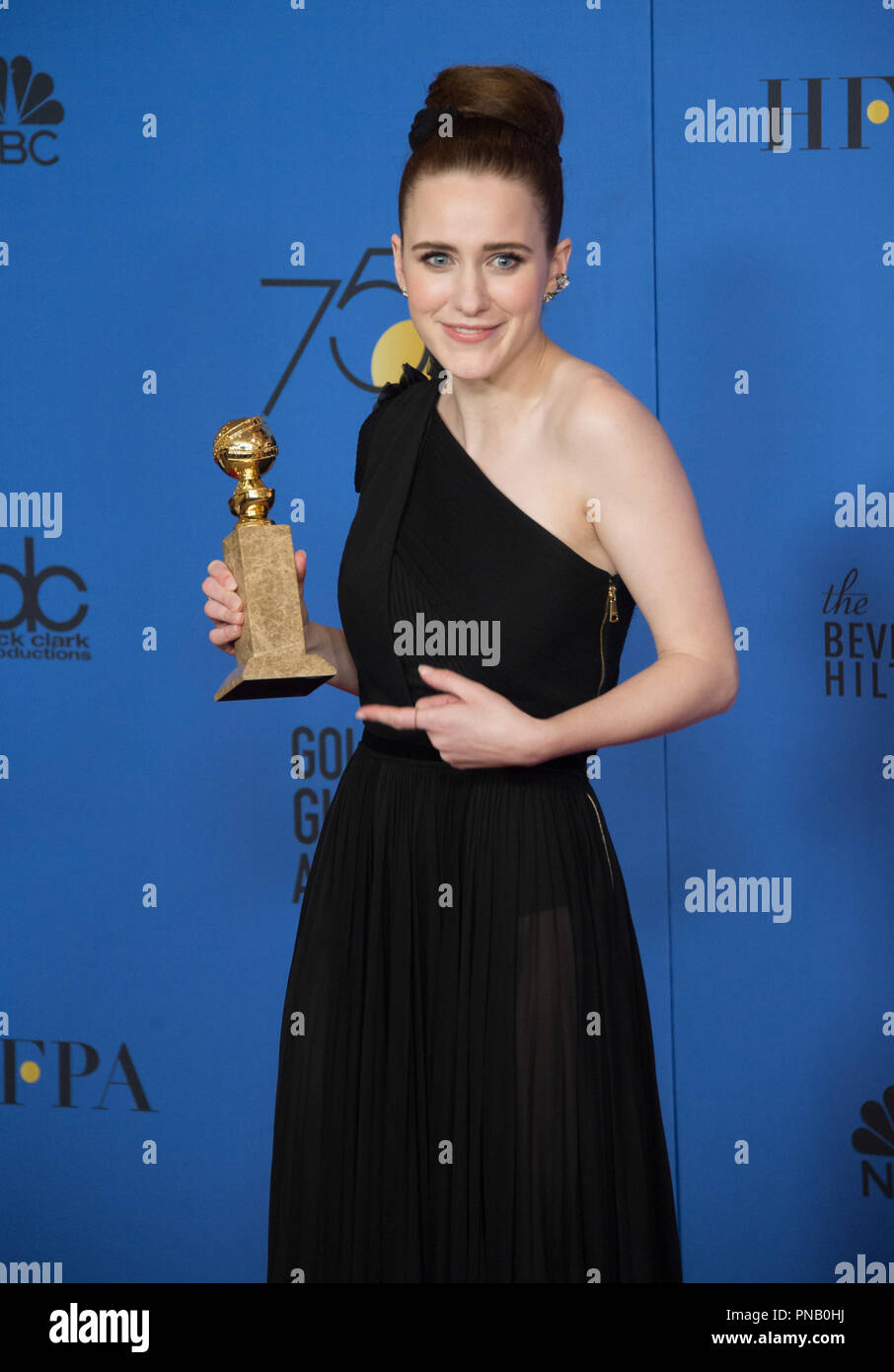 """After winning the category of BEST PERFORMANCE BY AN ACTRESS IN A TELEVISION SERIES – COMEDY OR MUSICAL for her role in """"The Marvelous Mrs. Maisel,"""" actress Rachel Brosnahan poses backstage in the press room with her Golden Globe Award at the 75th Annual Golden Globe Awards at the Beverly Hilton in Beverly Hills, CA on Sunday, January 7, 2018. Stock Photo"""